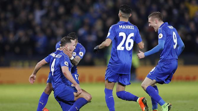 Leicester City's Danny Drinkwater celebrates scoring their second goal with teammates