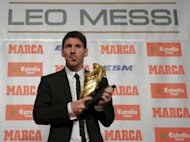 Barcelona's Argentinian forward Lionel Messi poses after receiving the European Golden Boot 2012 award for best European goalscorer of the 2011-2012 season, in Barcelona. Fresh from hitting his 300th career goal in a weekend swamping of Rayo Vallecano, Messi heads a 23-strong shortlist for a fourth FIFA/France Football Ballon d'Or (Golden Ball) award