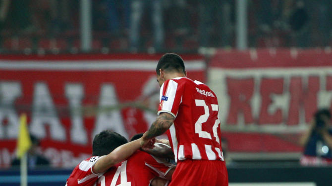 Olympiakos players celebrates their goal during the soccer Champions League group C match between Olympiakos and Paris Saint Germain in Piraeus, Greece, Tuesday, Sept. 17, 2013