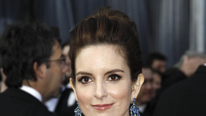 """FILE - This Feb. 26, 2012 file photo shows Tina Fey arriving at the 84th Academy Awards in the Hollywood section of Los Angeles. On Tuesday night, Fey received Audie Awards for Audio Book of the Year and best Biography/Memoir for her narration of her million-selling """"Bossypants."""" (AP Photo/Matt Sayles, file)"""