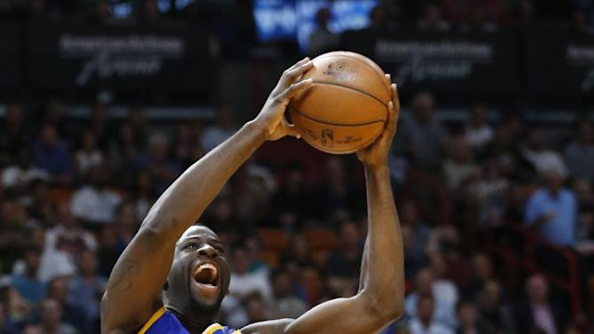 Golden State Warriors forward Draymond Green (23) goes up for a shot against Miami Heat forward Luke Babbitt (5) during the first half of an NBA basketball game, Monday, Jan. 23, 2017, in Miami. (AP Photo/Wilfredo Lee)