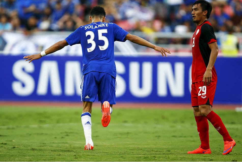 Solanke of Chelsea celebrates after scoring as Wasan of Thailand All-Stars stands behind during their friendly match in Bangkok