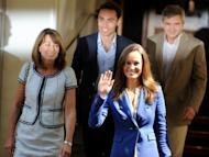 Carole, James, Michael and Philippa Middleton, the family of Catherine, duchess of Cambridge, leave the Goring Hotel in London on April 30, 2011. Kate Middleton was the middle-class girl who made becoming a princess look easy -- but bringing up a royal baby will bring fresh challenges for Britain's glamorous future queen