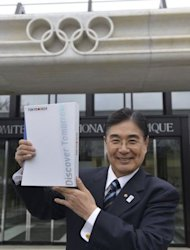 Tokyo 2020 CEO Masato Mizuno poses with the candidature files prior to the handover on January 7, 2013 at the headquarters of the International Olympic Committee in Lausanne