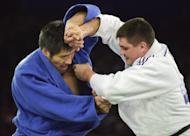 David Douillet of France fights against Shinichi Shinohara of Japan in his gold medal victory at the Sydney 2000 Olympic Games. Video replay technology will be used at the Olympic judo competition for the first time in an effort to eradicate judging controversies