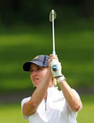 Karrie Webb of Australia watches her third shot on the fourth hole during the third round of the Wegmans LPGA Championship