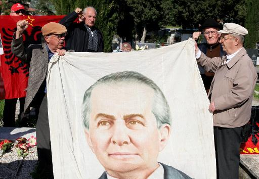 Albanian communist supporters pay their respects at the tomb of the late communist dictator Enver Hoxha in Tirana public cemetery, on April 11, 2013