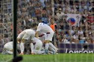 Korea's forward Park Chuyoung (C) celebrates with teammates after scoring the first goal against Japan during their London 2012 Olympic Games football bronze medal match, on August 10, at the Millenium stadium in Cardiff. S.Korea won 2-0