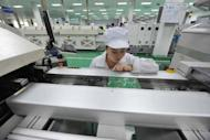 A worker is seen testing the circuit boards at a factory in Mianyang, southwest China's Sichuan province, on April 30. China's manufacturing activity rose in April to a 13-month high, official data showed, indicating the world's number two economy may have bottomed out in the second quarter