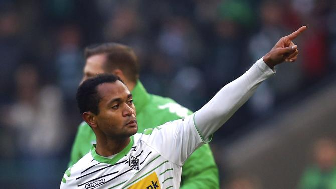 Borussia Moenchengladbach's Raffael celebrates his goal against Schalke 04 during their German first division Bundesliga soccer match in Moenchengladbach