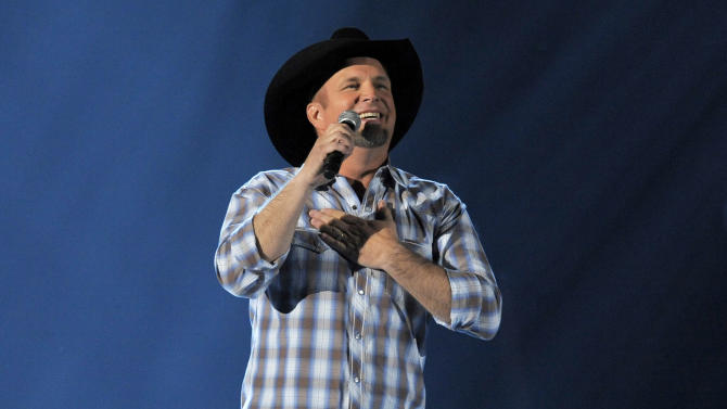 FILE - This April 7, 2013 file photo shows Garth Brooks performing at the 48th Annual Academy of Country Music Awards in Las Vegas, Nev. Brooks is a granddaddy. The country music superstar issued a statement Friday acknowledging the birth of his first grandchild, Karalynn. His daughter August gave birth earlier this week. (Photo by Chris Pizzello/Invision/AP, File)