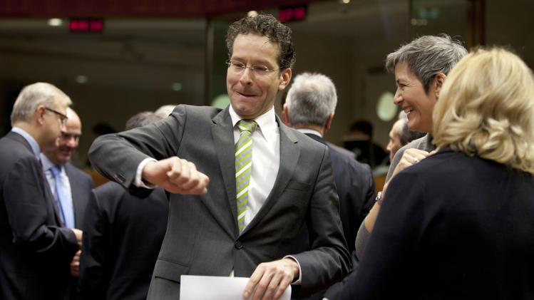 Dutch Finance Minister and newly appointed chief of the eurogroup Jeroen Dijsselbloem, center, gestures as he speaks with Austria's Finance Minister Maria Fekter, right, and Denmark's Economy Minister Margrethe Vestager, second right, during a meeting of EU finance ministers at the EU Council building in Brussels on Tuesday, Jan. 22, 2013. Eleven eurozone countries seeking to unilaterally implement a financial transaction tax are expected Tuesday to receive the blessing of other European Union countries, bringing the once-controversial project one step closer to reality. (AP Photo/Virginia Mayo)