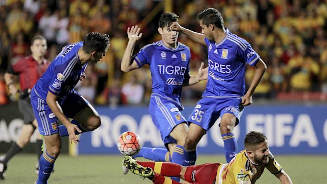 Elias Aguilar (bottom R) of Costa Rica's Herediano is fouled by Jorge Torres (L) of Mexico's Tigres as Alonso Zamora (top R) looks on during their CONCACAF Champions League soccer match at Eladio Rosabal Cordero stadium in Heredia