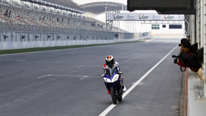 2010 World MotoGP Champion Jorge Lorenzo rides a Yamaha YZF-R15 during his visit to Buddh International Circuit, an Indian motor racing circuit, in Greater Noida, on the outskirts of New Delhi, India, Wednesday, Jan. 11, 2012. (AP Photo/Pankaj Nangia)
