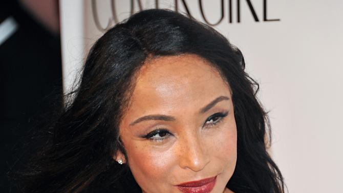 "FILE - In this Sept. 30, 2010 file photo, singer Sade Adu arrives at the ""Keep A Child Alive Black Ball"" at the Hammerstein Ballroom in New York. Sade, the Grammy-winning veteran soul band, released a live DVD this week called ""Bring Me Home – Live 2011."" It features behind-the-scene moments and more from the group's U.S. tour last year. (AP Photo/Evan Agostini, file)"