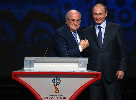 FIFA's President Blatter shakes hands with Russia's President Putin during the preliminary draw for the 2018 FIFA World Cup at Konstantin Palace in St. Petersburg