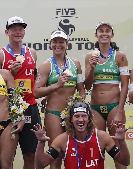 Aleksandrs Samoilovs and Janis Smedins of Latvia celebrate with Larissa Franca and Talita Antunes of Brazil after winning their Rio Open beach volleyball final match on Copacabana beach in Rio de Jane