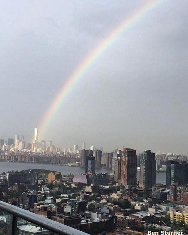 On the eve of the 14th anniversary of the September 11 terror attacks, a rainbow appears to emerge from One World Trade Center in downtown Manhattan.