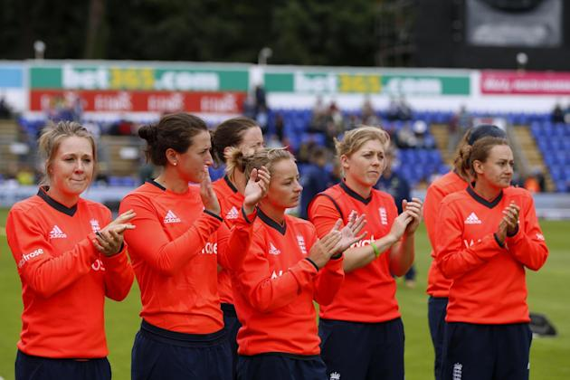England players applaud during the presentation after the match