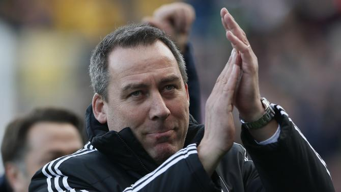 Fulham manager Rene Meulensteen reacts ahead of their English Premier League soccer match against Aston Villa at Craven Cottage in London