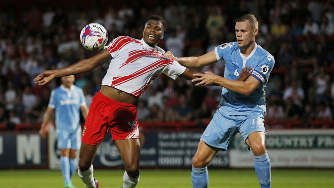 Stevenage's Rowan Liburd in action with Stoke City's Ryan Shawcross