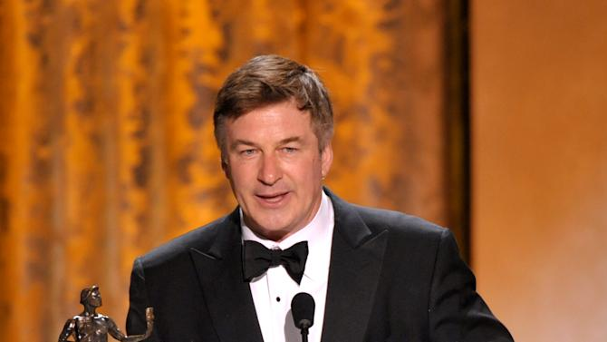 """Alec Baldwin accepts the award for outstanding male actor in a comedy series for """"30 Rock"""" at the 19th Annual Screen Actors Guild Awards at the Shrine Auditorium in Los Angeles on Sunday Jan. 27, 2013. (Photo by John Shearer/Invision/AP)"""