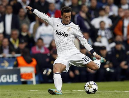 Real Madrid's Ozil shoots towards the goal of Borussia Dortmund during their Champions League semi-final second leg match at Santiago Bernabeu stadium in Madrid