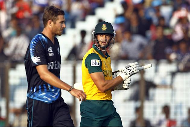 South Africa's Albie Morkel, right, walks back to the pavilion after his dismissal by New Zealand's Tim Southee, left, during their ICC Twenty20 Cricket World Cup match against New Zealand in