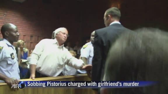 Sobbing Pistorius charged with girlfriend's murder