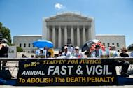 People attend the 20th annual Starvin' for Justice fast and vigil against the death penalty in front of the US Supreme Court in Washington on June 29, 2013