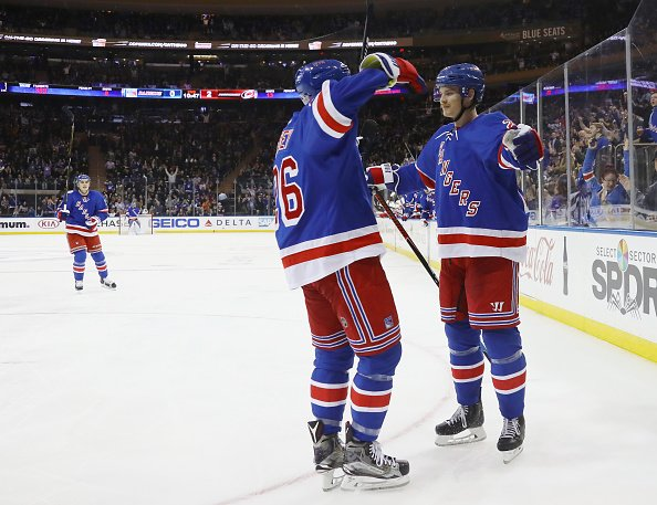NEW YORK, NY - NOVEMBER 29: Nick Holden #22 of the New York Rangers (R) celebrates his goal at 9:13 of the second period against the Carolina Hurricanes and is joined by Jimmy Vesey #26 (L) at Madison Square Garden on November 29, 2016 in New York City. (Photo by Bruce Bennett/Getty Images)