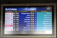 "An arrival information screen shows the delayed Air Algerie flight 5017 (top) at the Houari Boumediene airport near Algiers, Algeria, Thursday, July 24, 2014. An Air Algerie flight carrying 116 people from Burkina Faso to Algeria's capital disappeared from radar early Thursday over northern Mali and ""probably crashed"" according to the plane's owner and government officials in France and Burkina Faso. (AP Photo/Sidali Djarboub)"