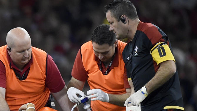 Wales' Leigh Halfpenny leaves the field injured and given oxygen