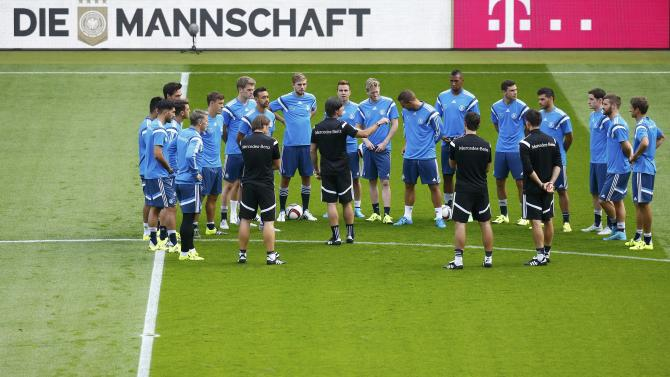Loew, coach of the German national soccer team talks to his squad during a training session in Frankfurt