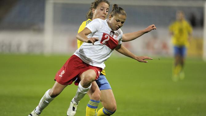 Poland's Aleksandra Sikora, front, fights for the ball with Sweden's Antonia Gransson, during the ladies' football World Championships qualification match at Swedbank Stadium in Malmo, Sweden, Saturday September 21, 2013. (AP Photo / Scanpix Sweden,Bjorn Lindgren)