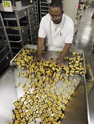 FILE - In this May 26, 2011 file photo, Kodak employee, Earl Blackmon, loads medium format film into a hopper for packaging during a product change in Rochester, N.Y. (AP Photo/David Duprey, file)