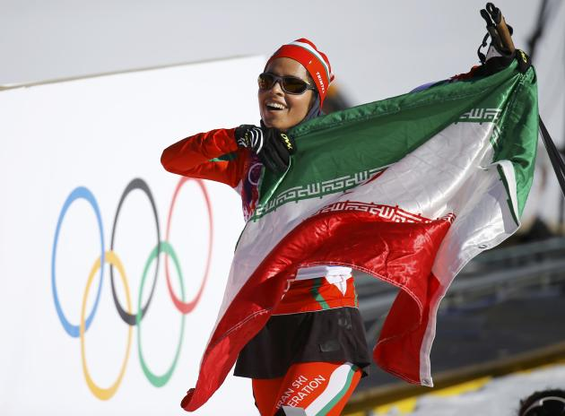 Iran's Rezasoltani celebrates with national flag after women's cross-country 10km classic event at 2014 Sochi Winter Olympics