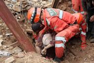Rescuers pull a survivor from debris after an earthquake hit Ludian county in Zhaotong, in China's southwestern Yunnan province on August 4, 2014