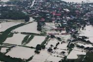 This handout photo taken on August 10, and released by the Malacanang Photo Bureau shows an aerial view of flooding around Pampanga, north of Manila. Asian nations must act quickly to protect their cities from flooding and other natural disasters as rapid urbanisation raises environmental risks, the Asian Development Bank said Wednesday