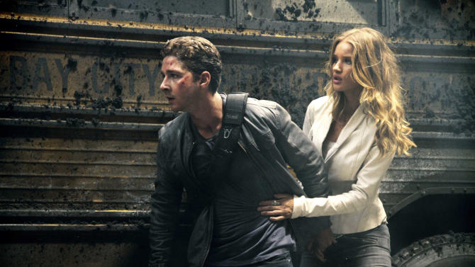 "FILE-  In this file film publicity image released by Paramount Pictures, Shia LaBeouf plays Sam Witwicky, left, and Rosie Huntington-Whiteley plays Carly Miller in a scene from ""Transformers: Dark of the Moon."" ""Transformers"" director Michael Bay says 41-year-old actor Mark Wahlberg will star in the upcoming fourth ""Transformers"" film. (AP Photo/Paramount Pictures, Robert Zuckerman, File)"