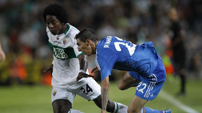 Real Madrid's Angel Di Maria from Argentina, right, colliding with Elche's Carlos Alberto Sanchez Moreno, left,  during their La Liga soccer match at the Martinez Valero stadium in Elche, Spain, Wednesday, Sept. 25, 2013