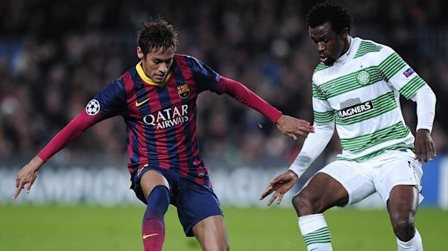 Neymar battles with Efe Ambrose (AFP)