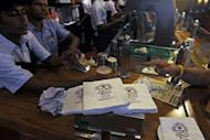 Baristas serve a customer at a Coffee Bean and Tea Leaf outlet in Mumbai on July 18. Starbucks is betting on big returns as it seeks to lure an expanding legion of coffee lovers in India -- primarily a tea-drinking nation where lifestyle changes have spawned a booming market for cafes