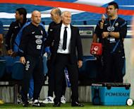 French national football head coach Didier Deschamps (C) and assistant coach Guy Stephan (L) react at the end of the friendly football match France vs Uruguay at the Oceane stadium in Le Havre, western France. Deschamps said he would not allow dissent from France's fans to intrude upon his memories of his first match in charge of the national team, after their 0-0 draw