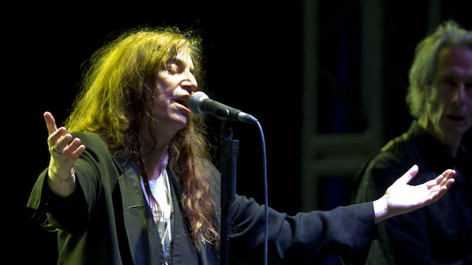 FILE - This May 5, 2012 file photo shows U.S. rock singer Patti Smith performing during her concert in Mexico City. Smith will be honored by Bryn Mawr College for her artistic accomplishments and pioneering spirit. The women's liberal arts school near Philadelphia announced that Smith will receive the 2013 Katharine Hepburn Medal. Bryn Mawr will award the Hepburn Medal to Smith at a campus event on Feb. 7. A performance for students is being planned. (AP Photo/Eduardo Verdugo, file)