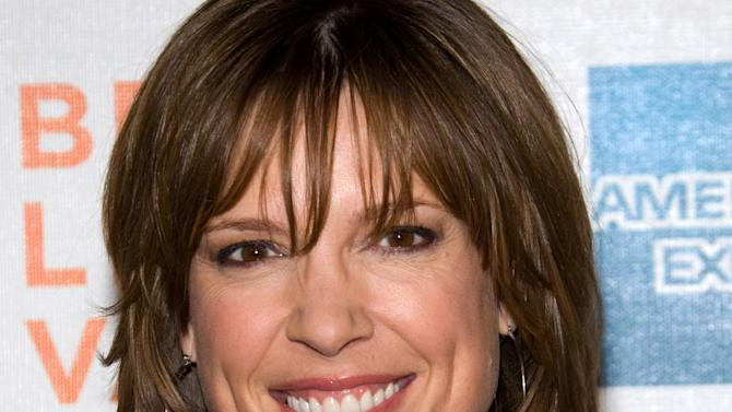 """FILE - In this Friday, April 23, 2010 file photo, Hannah Storm attends the premiere of """"Straight Outta L.A."""" as part of the Tribeca Film Festival in New York. ESPN anchor Storm will return to the air on New Year's Day, exactly three weeks after she was seriously burned in a propane gas grill accident at her home. Storm suffered second-degree burns on her chest and hands, and first-degree burns to her face and neck. She lost her eyebrows and eyelashes, and roughly half her hair. (AP Photo/Charles Sykes, File)"""