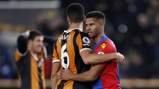 Hull City's Curtis Davies and Crystal Palace's Fraizer Campbell embrace at the end of the match