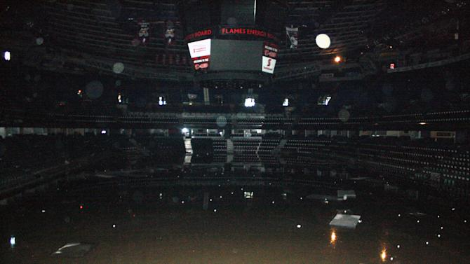 This undated photo provided by the Calgary Flames shows the inside of the Calgary Saddledome in Calgary, Alberta. The Saddledome, home to the National Hockey League's Calgary Flames, was flooded up to the 10th row, leaving the dressing rooms submerged. The two rivers that converge on the western Canadian city of Calgary are receding Saturday, June 22, 2013 after floods devastated much of southern Alberta province, causing at least three deaths and forcing thousands to evacuate. (AP Photo/Calgary Flames)