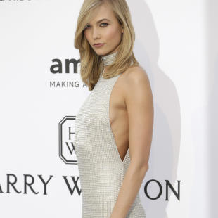 Model Karlie Kloss poses for photographers upon arrival for the amfAR Cinema Against AIDS benefit at the Hotel du Cap-Eden-Roc, during the 68th Cannes international film festival, Cap d'Antibes, southern France, Thursday, May 21, 2015. (AP Photo/Thibault Camus)