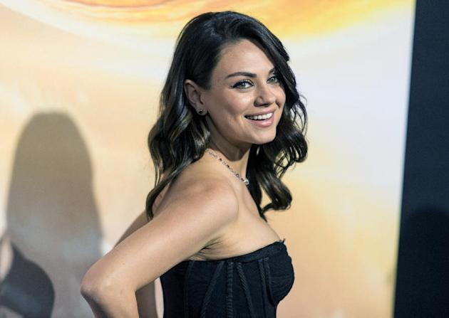 FILE - In this Feb. 2, 2015, file photo, actress Mila Kunis attends a premiere at TCL Chinese Theatre in Hollywood, Calif. Authorities are looking for a man sentenced for stalking Kunis after he escap
